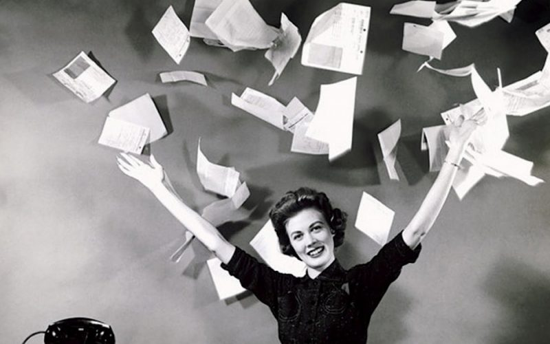 woman-vintage-black-and-white-throwing-bills-paper-into-air-800x500.jpg